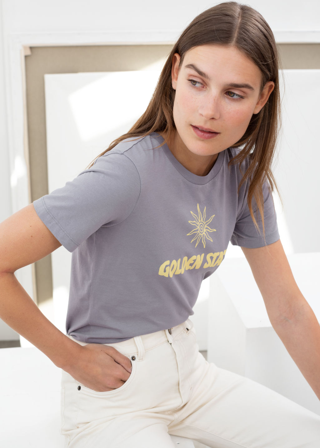 Model front image of Stories sunset graphic tee in blue