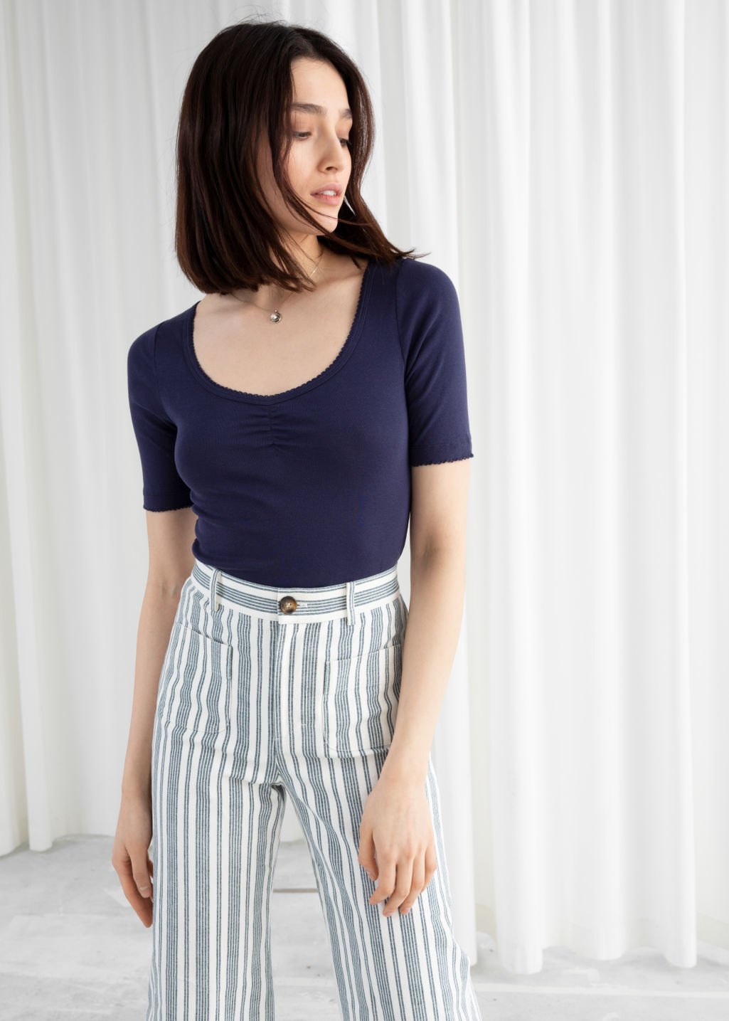 Model front image of Stories fitted crop top in blue