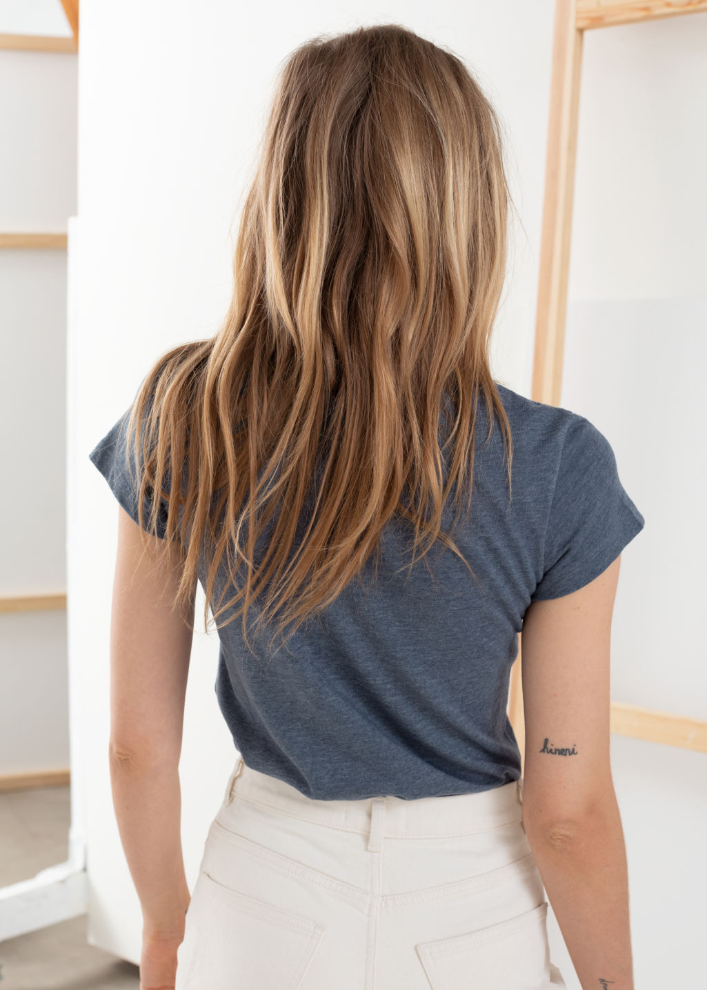 Model back image of Stories cotton blend tee in blue