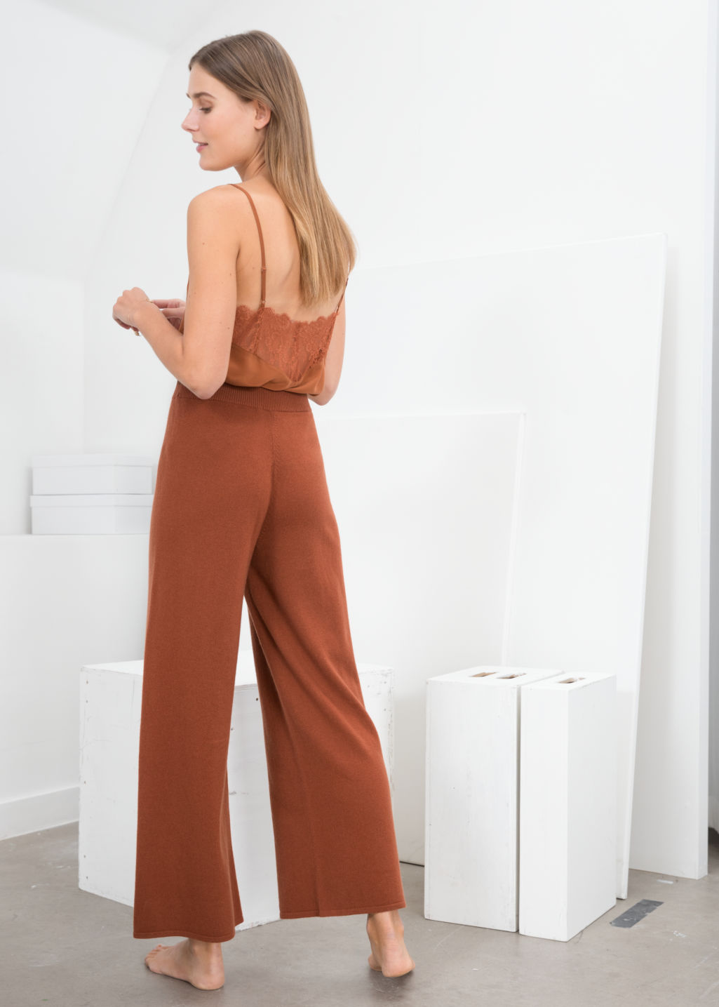 Model back image of Stories cashmere knit lounge trousers in brown