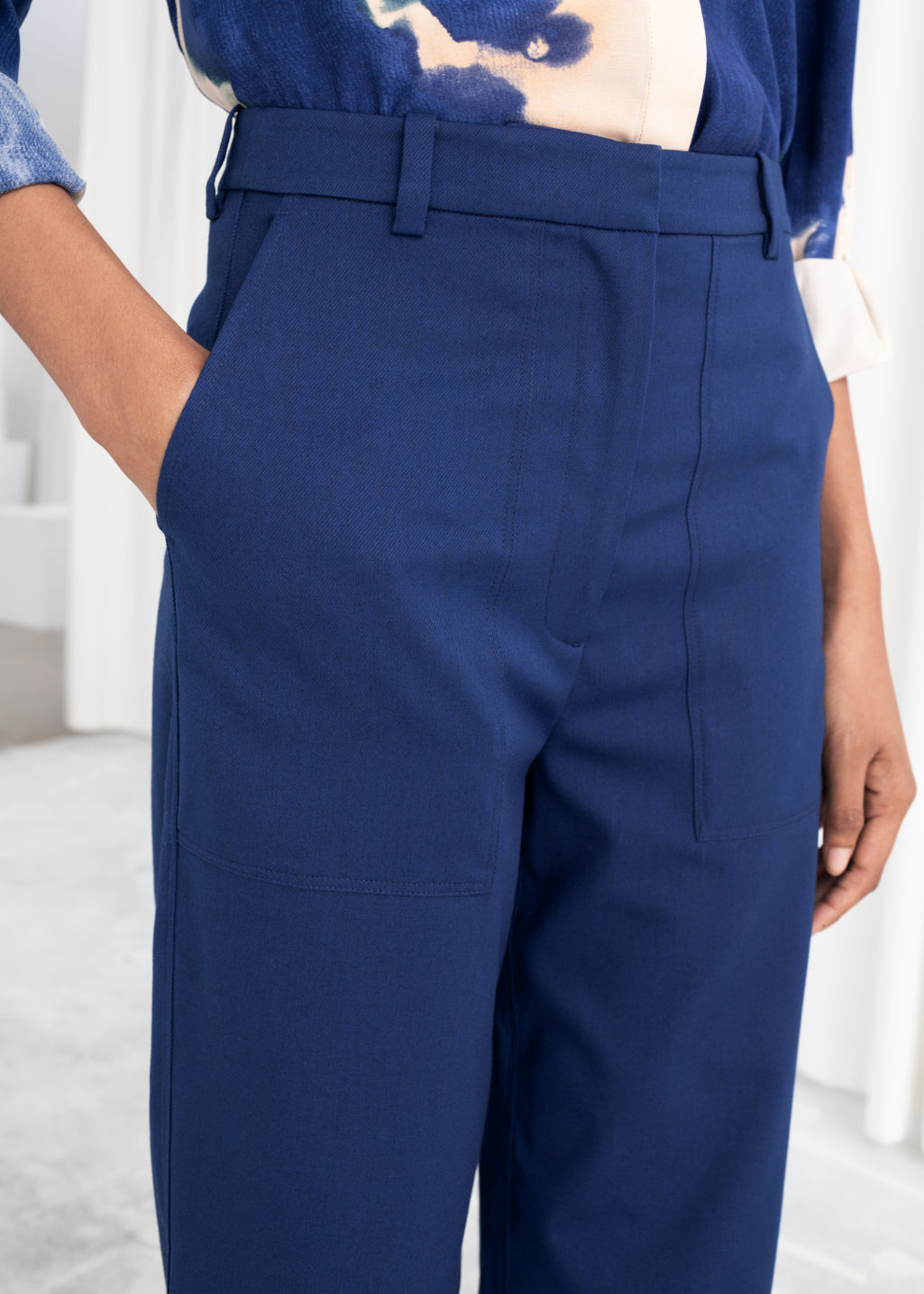 Model back image of Stories high waisted relaxed fit trousers in blue