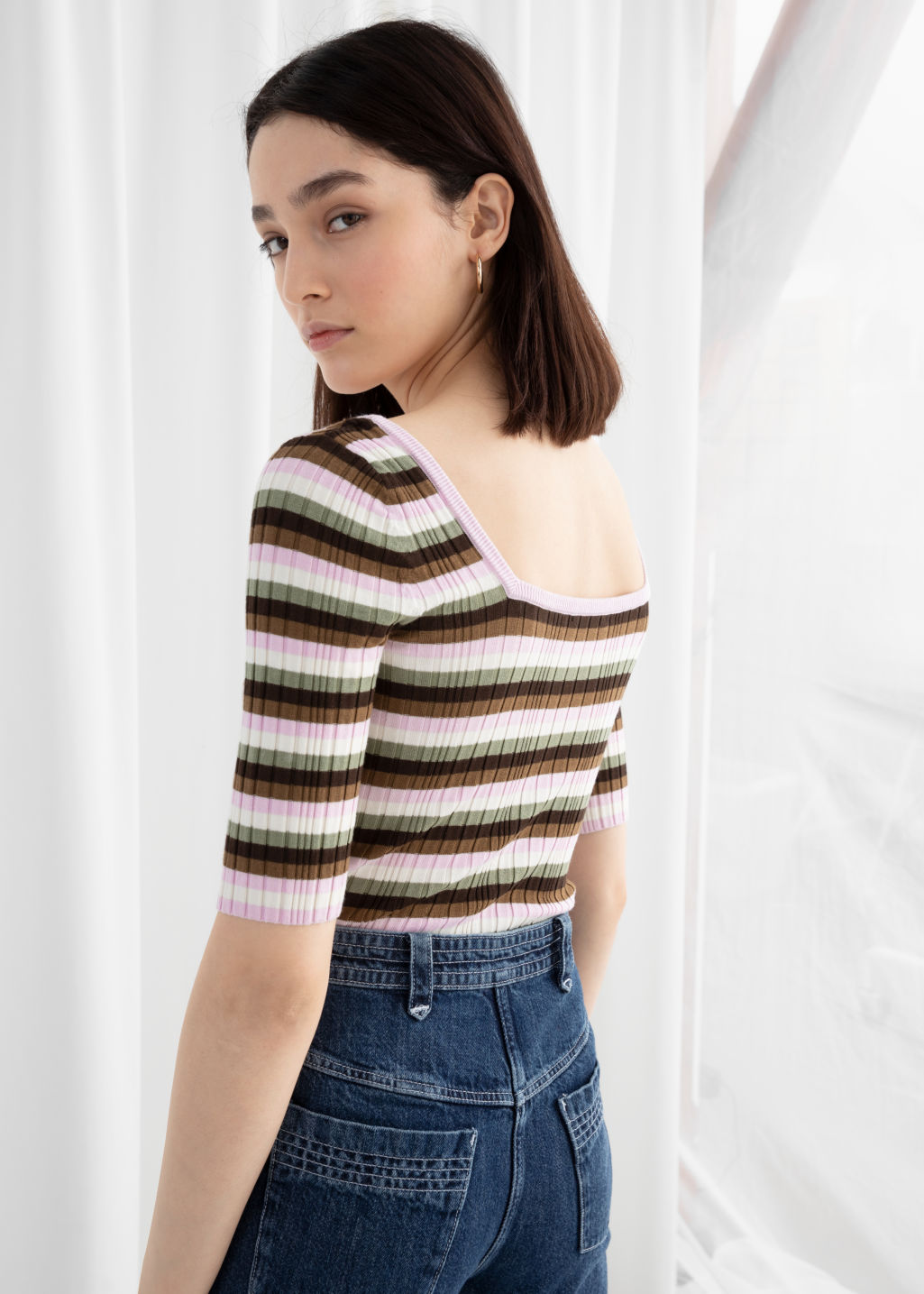 Model back image of Stories fitted striped micro knit top in beige