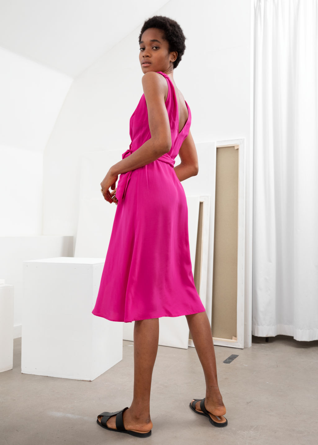Model back image of Stories sleeveless midi wrap dress in pink