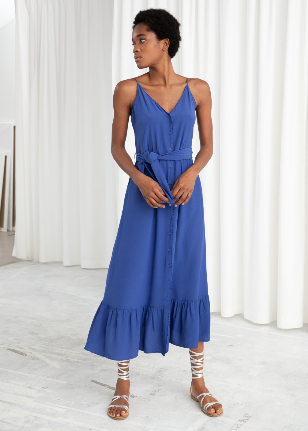 Model front image of Stories belted button up midi dress in blue