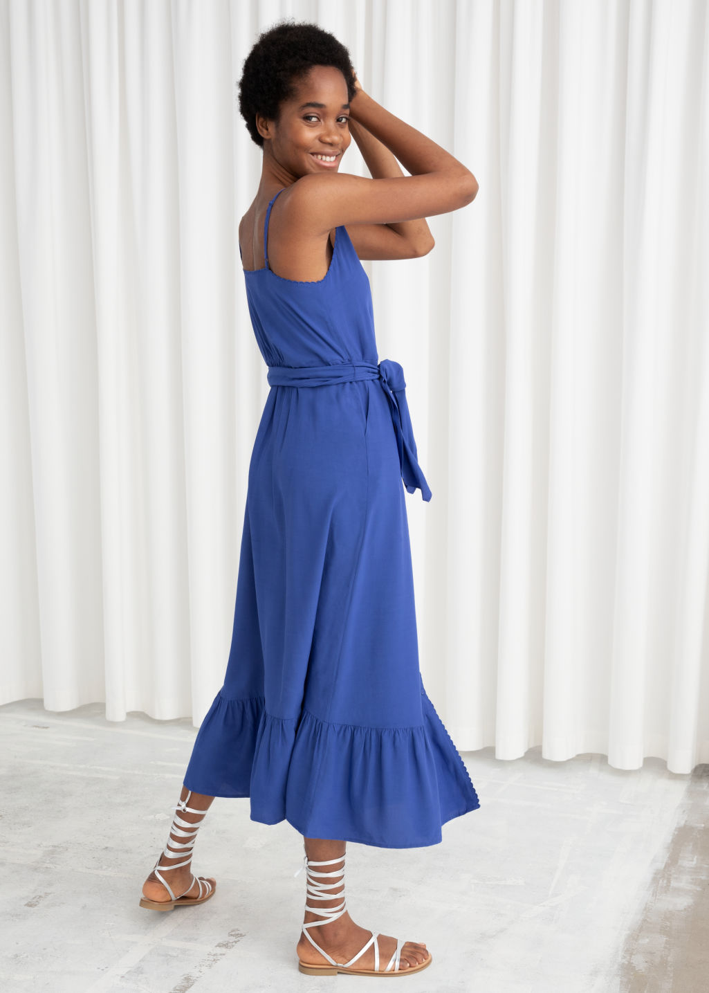 Model back image of Stories belted button up midi dress in blue