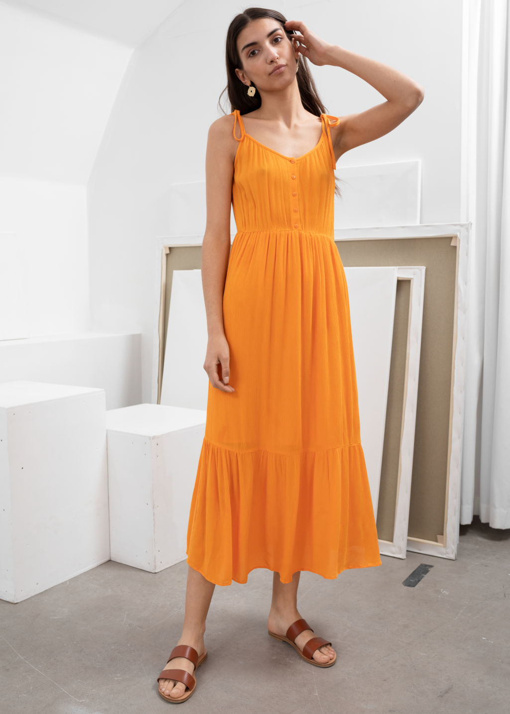 Model front image of Stories ruffled tie shoulder midi dress in orange