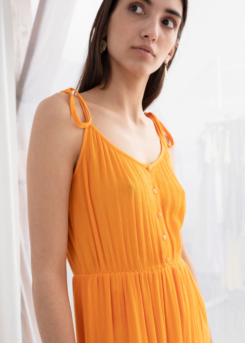 Model back image of Stories ruffled tie shoulder midi dress in orange
