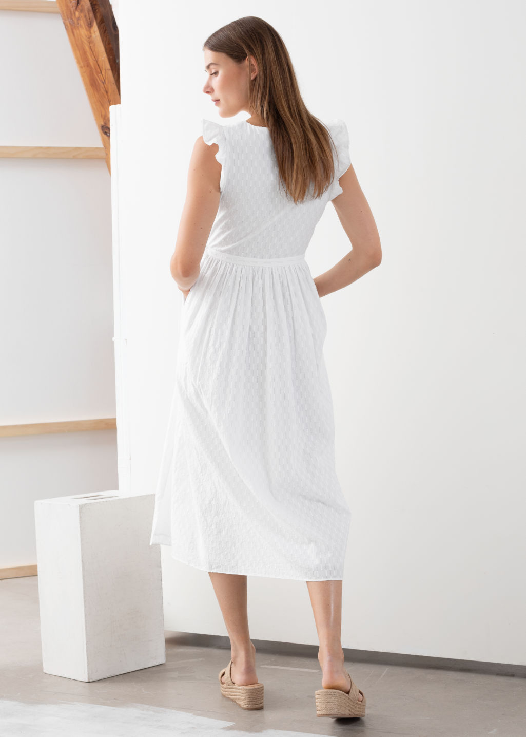 Model back image of Stories ruffled cotton dobby midi dress in white