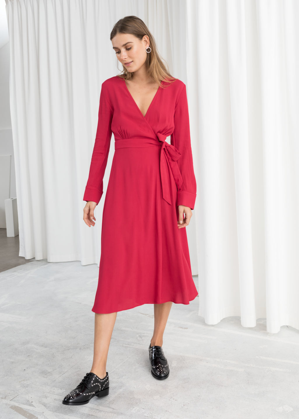 Model front image of Stories midi wrap dress in red