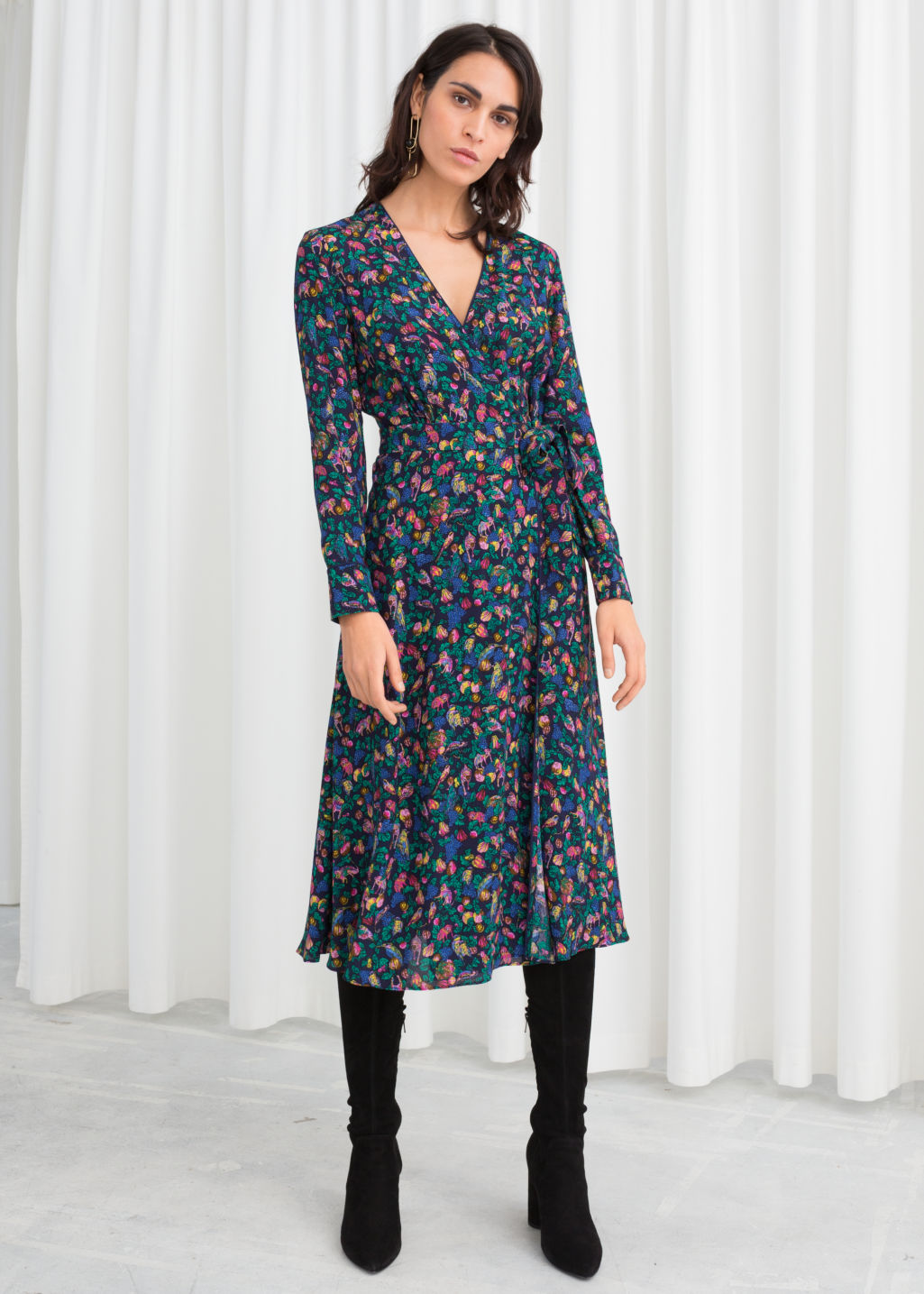 Model front image of Stories midi wrap dress in blue