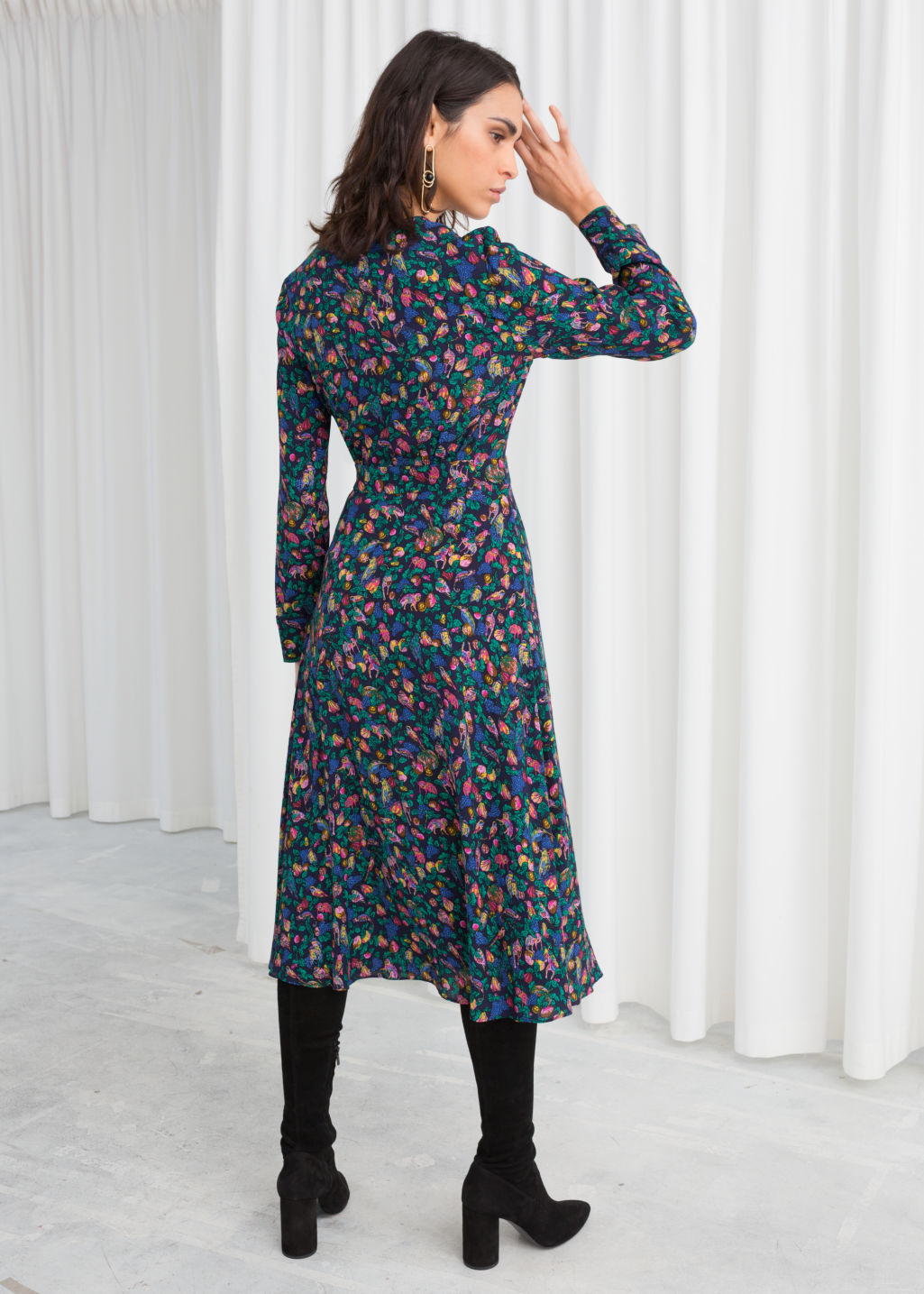 Model back image of Stories midi wrap dress in blue