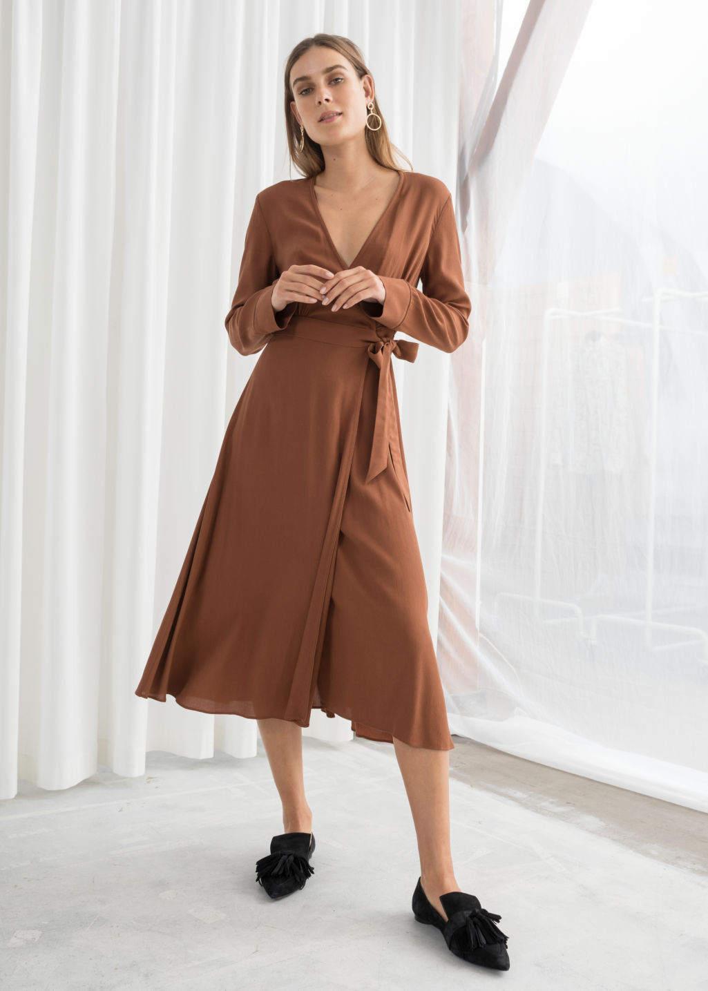 Model front image of Stories midi wrap dress in beige