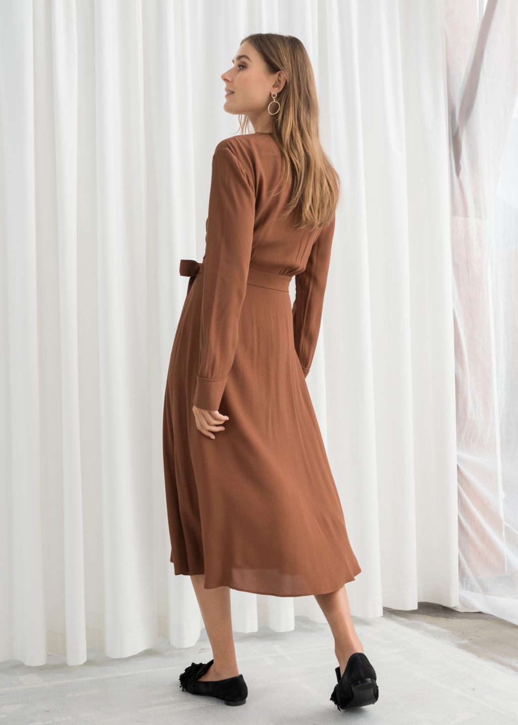 Model back image of Stories midi wrap dress in beige
