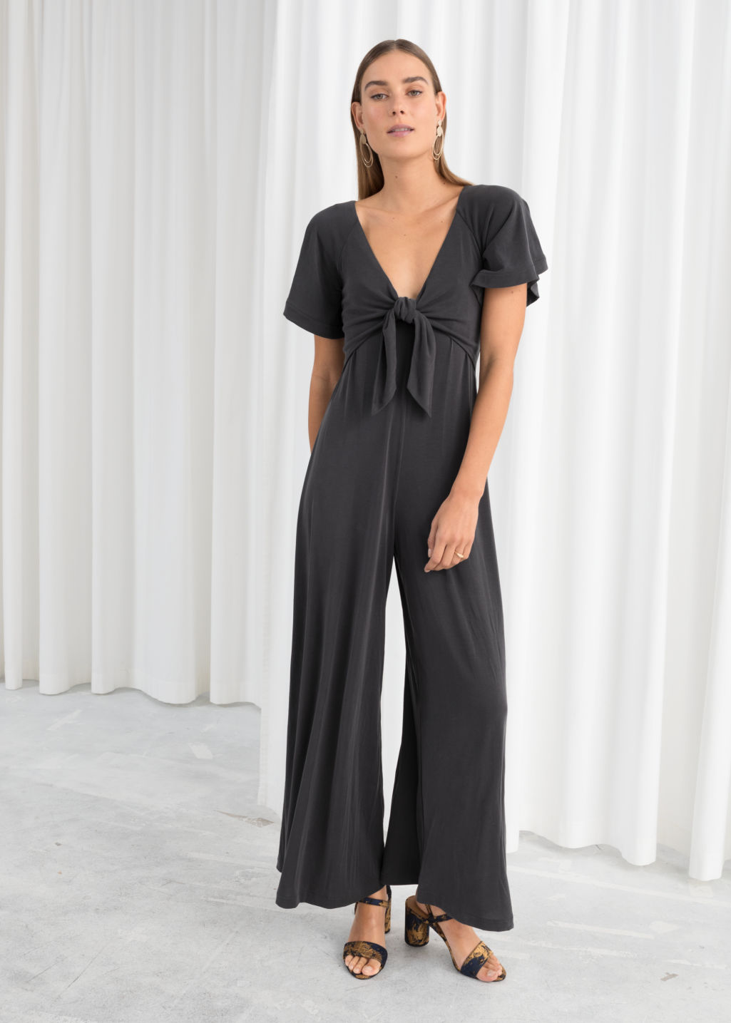 Model front image of Stories tie up midi dress in black