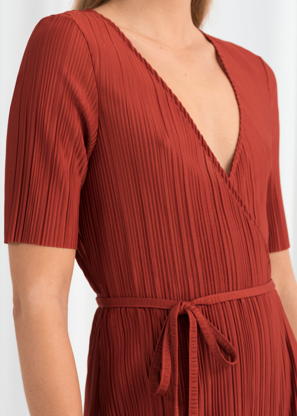 Model back image of Stories plissé pleated wrap dress in orange