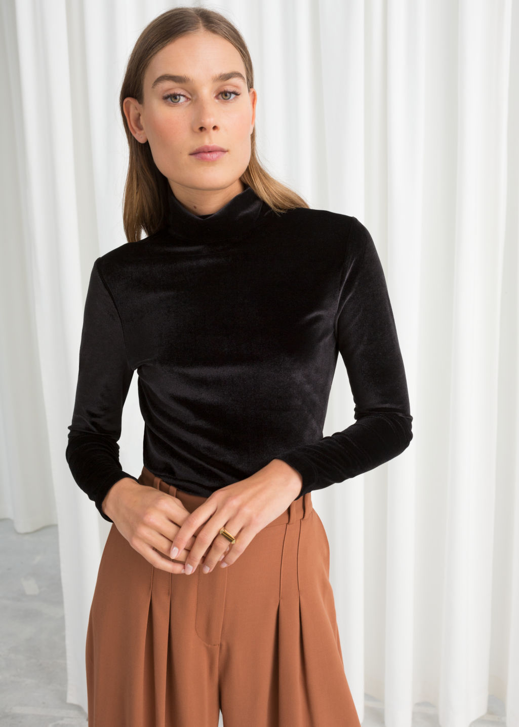 Model front image of Stories fitted velvet turtleneck in black