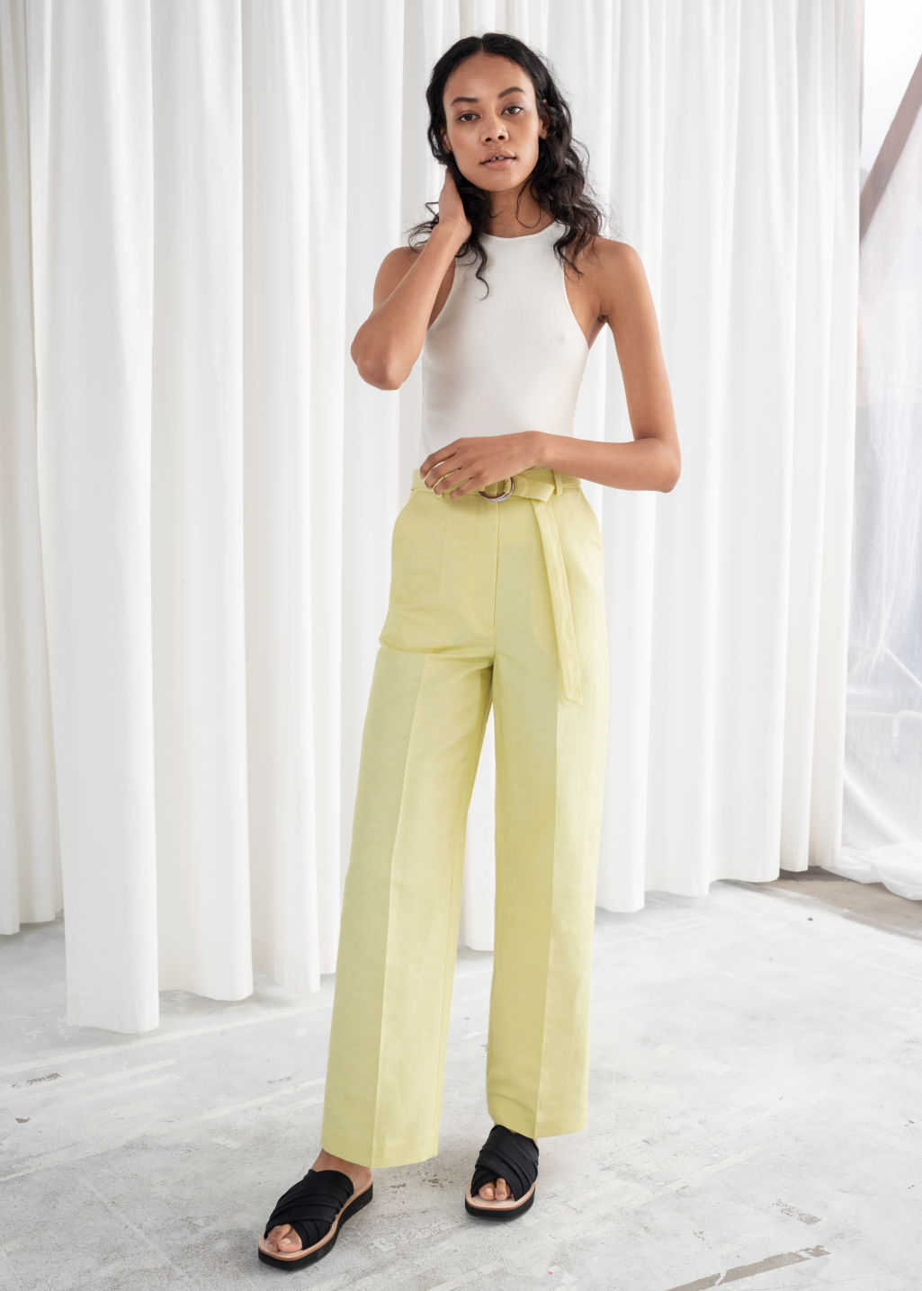 Model front image of Stories belted cotton linen blend trousers in yellow