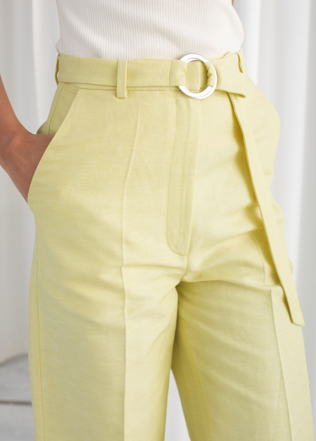 Model back image of Stories belted cotton linen blend trousers in yellow