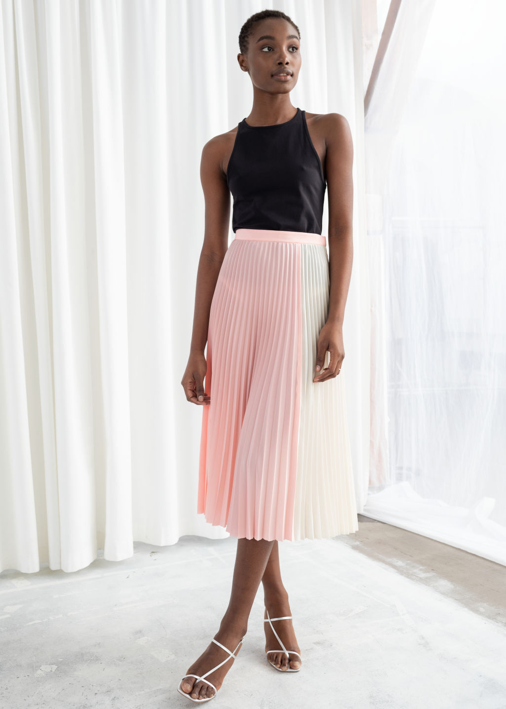 Model front image of Stories duo toned pleated midi skirt in pink