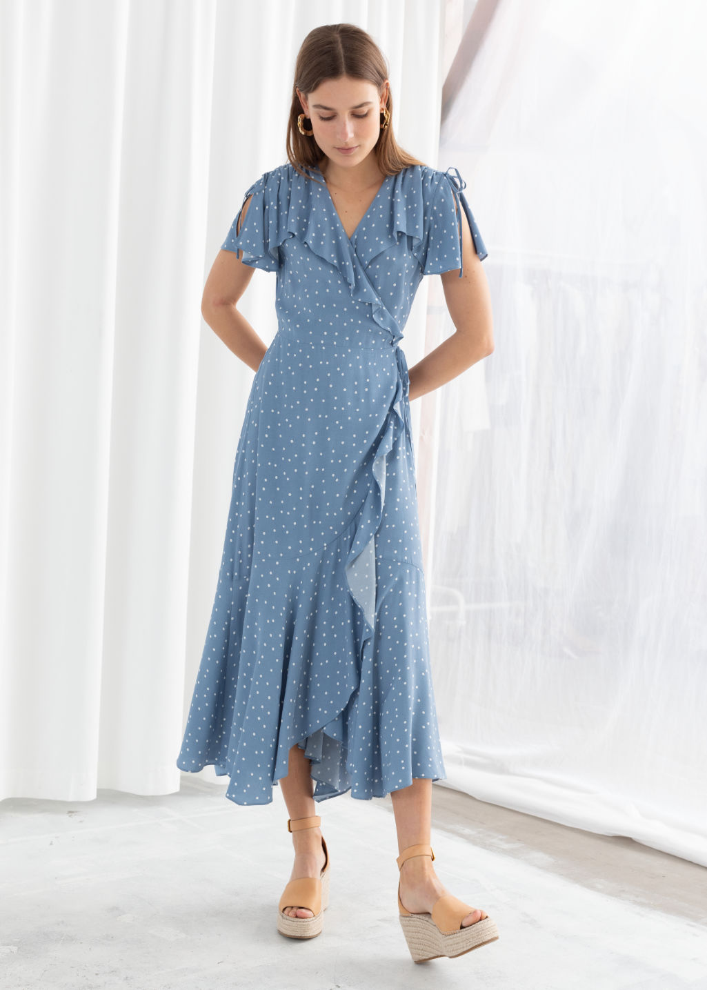 Model front image of Stories ruffled handkerchief wrap midi dress in blue