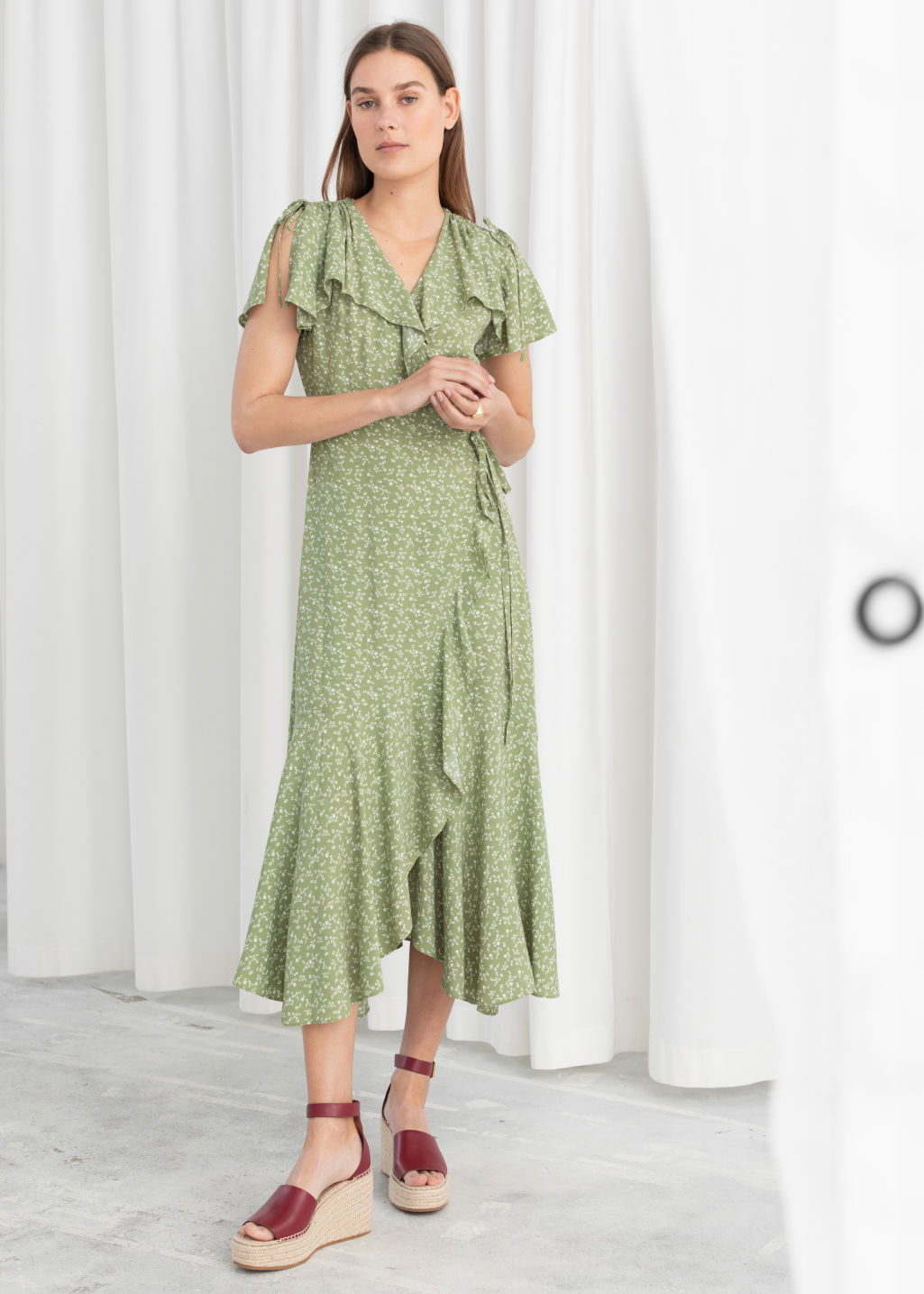 Model front image of Stories ruffled handkerchief wrap midi dress in green