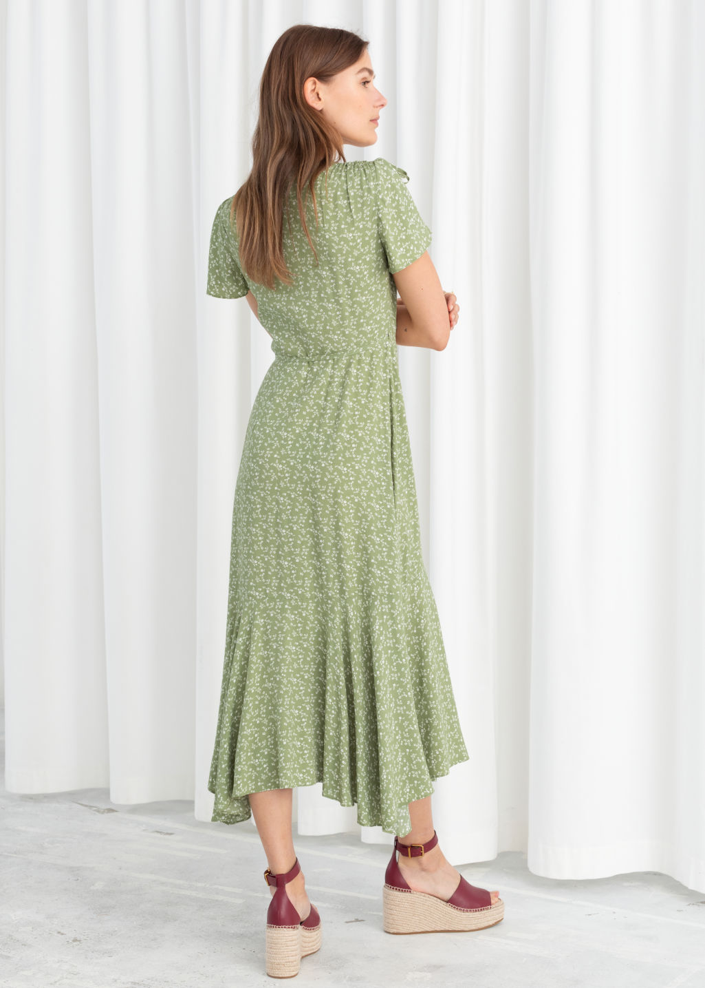 Model back image of Stories ruffled handkerchief wrap midi dress in green