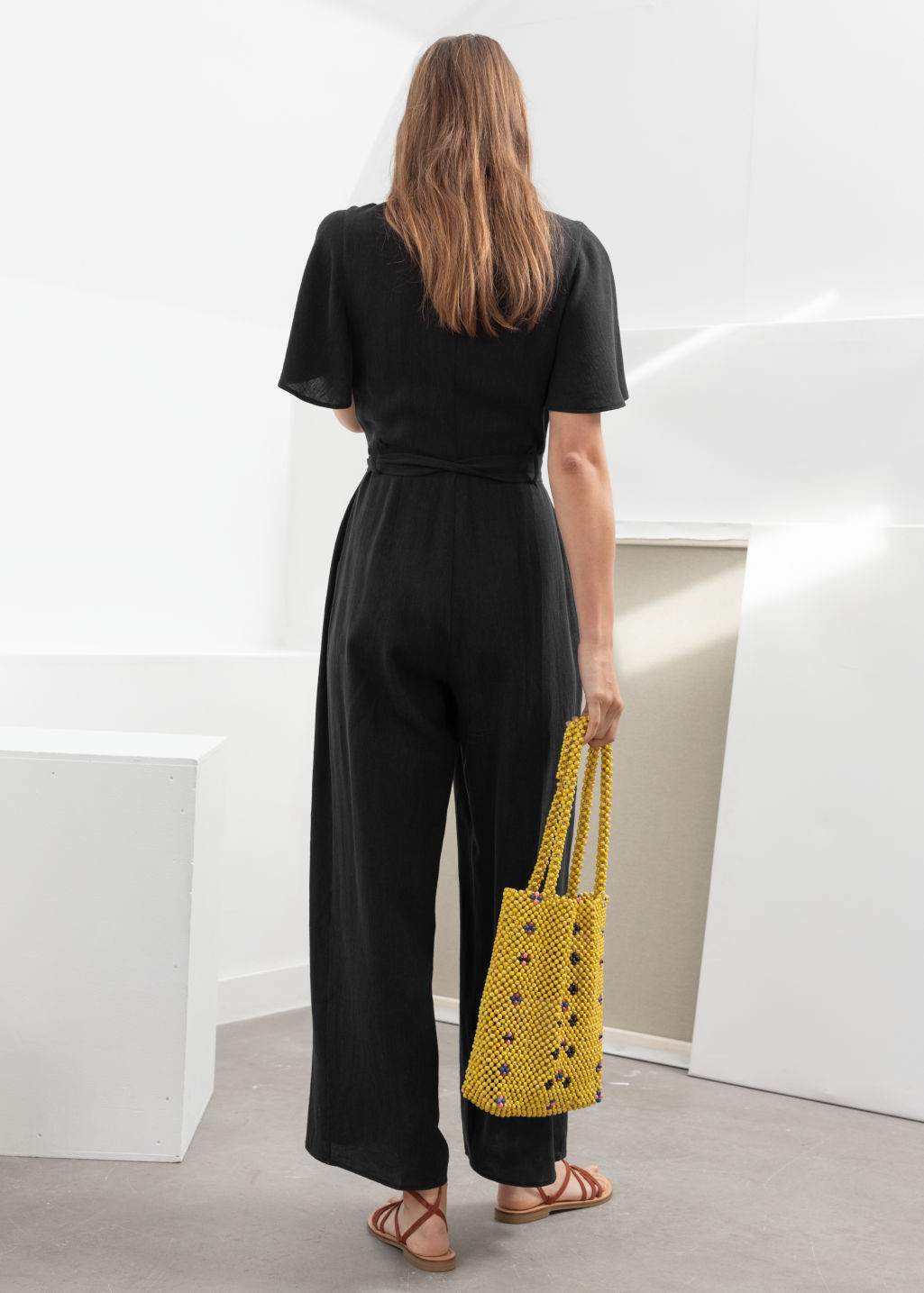 Model back image of Stories linen blend jumpsuit in black