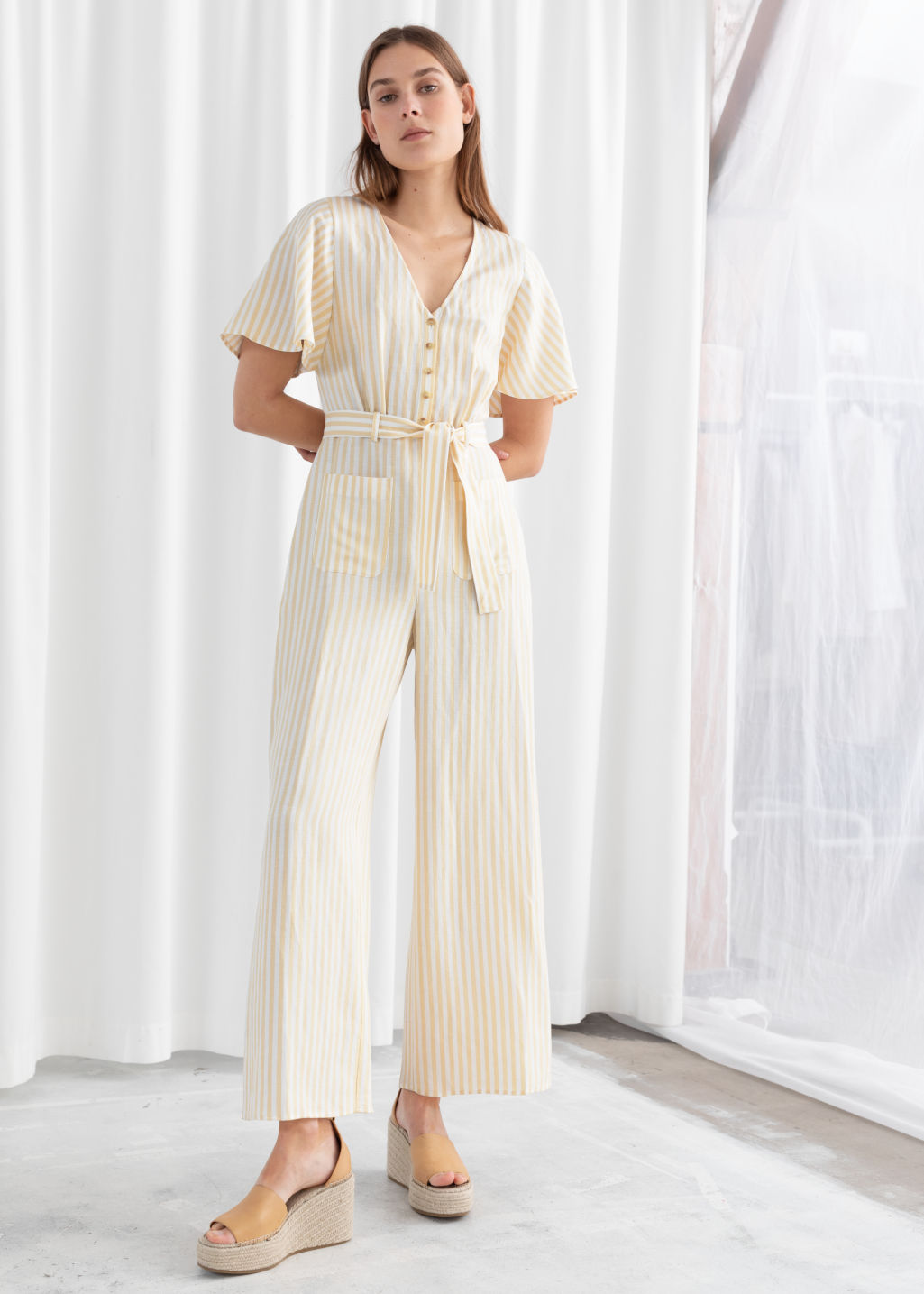 Model front image of Stories linen blend jumpsuit in yellow