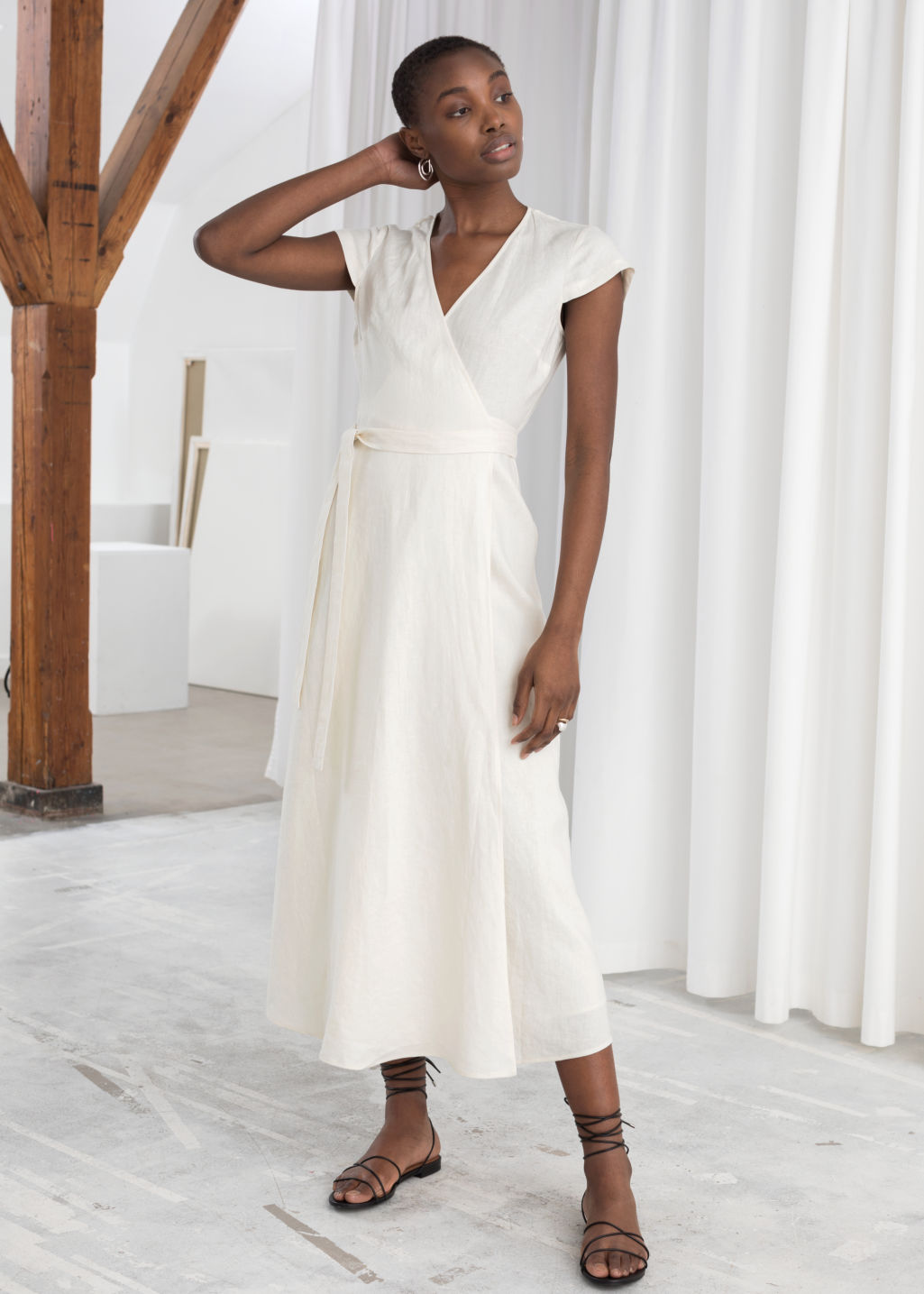 Model front image of Stories linen midi wrap dress in white
