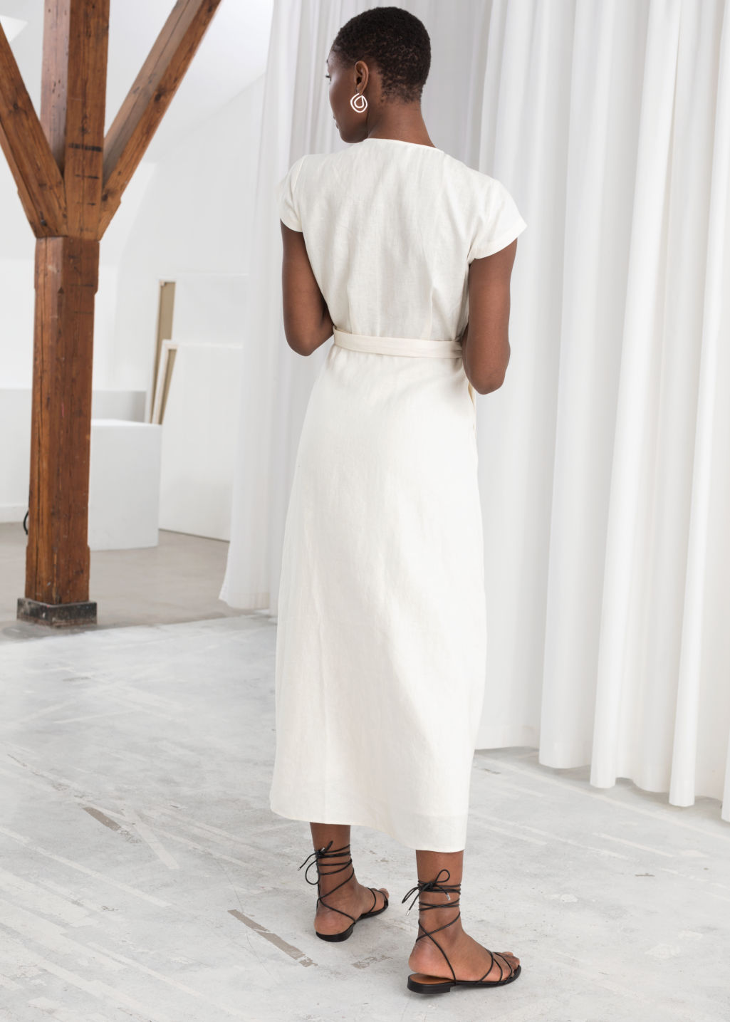Model back image of Stories linen midi wrap dress in white