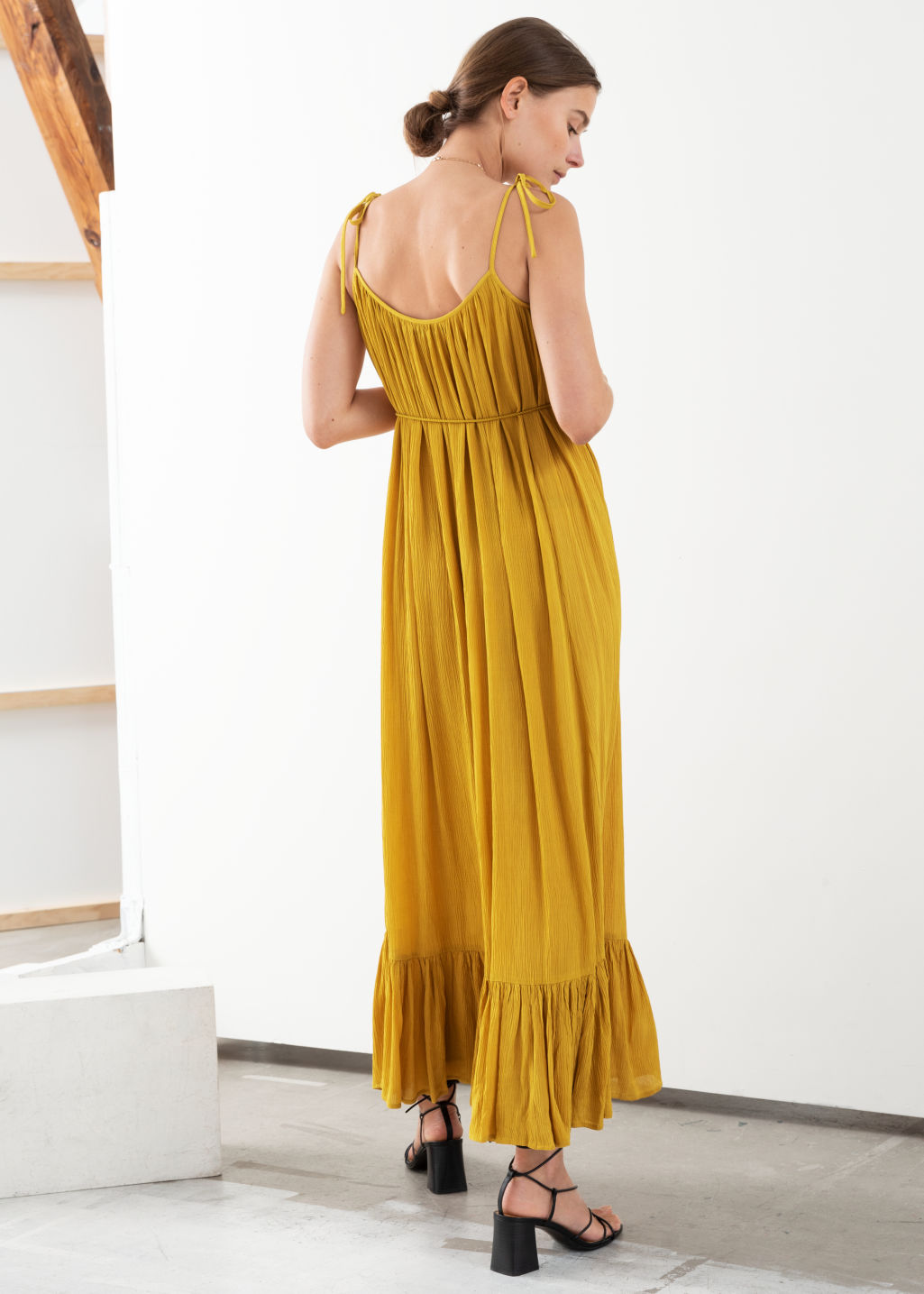 Model back image of Stories gathered maxi dress in yellow