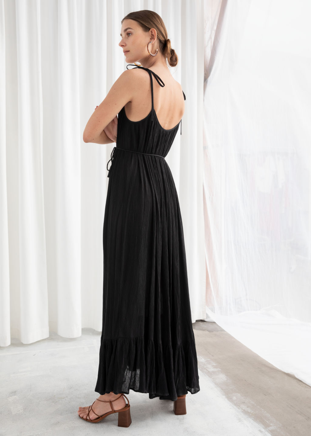 Model back image of Stories gathered maxi dress in black