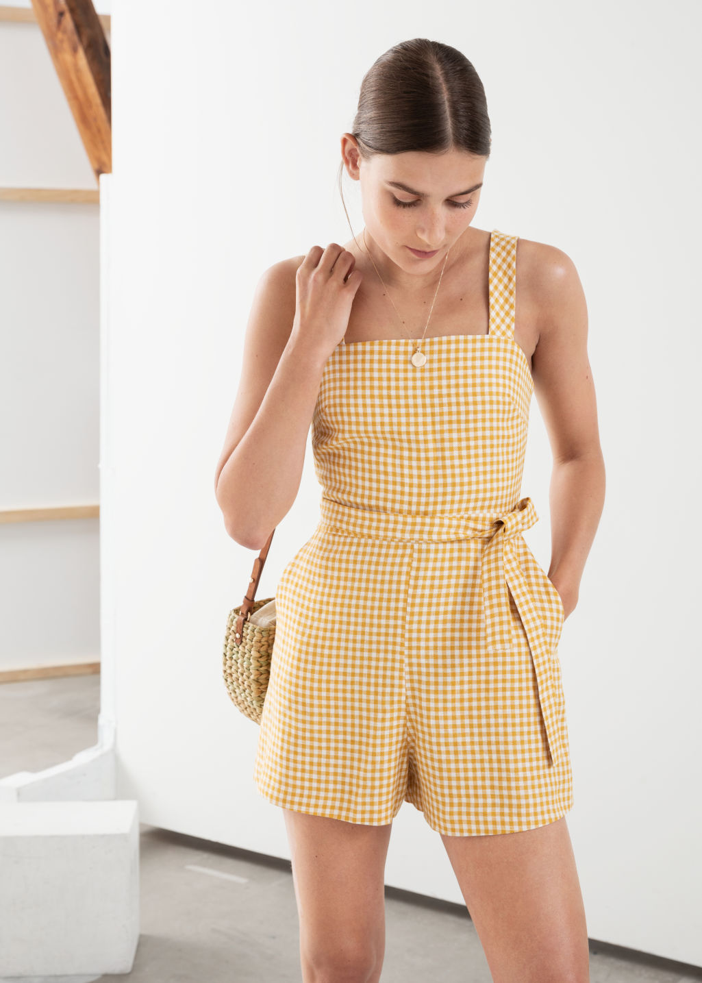 Model front image of Stories square neck linen romper in yellow