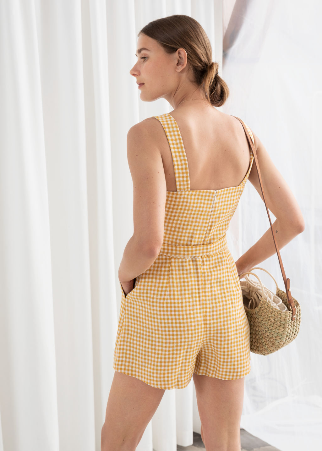 Model back image of Stories square neck linen romper in yellow