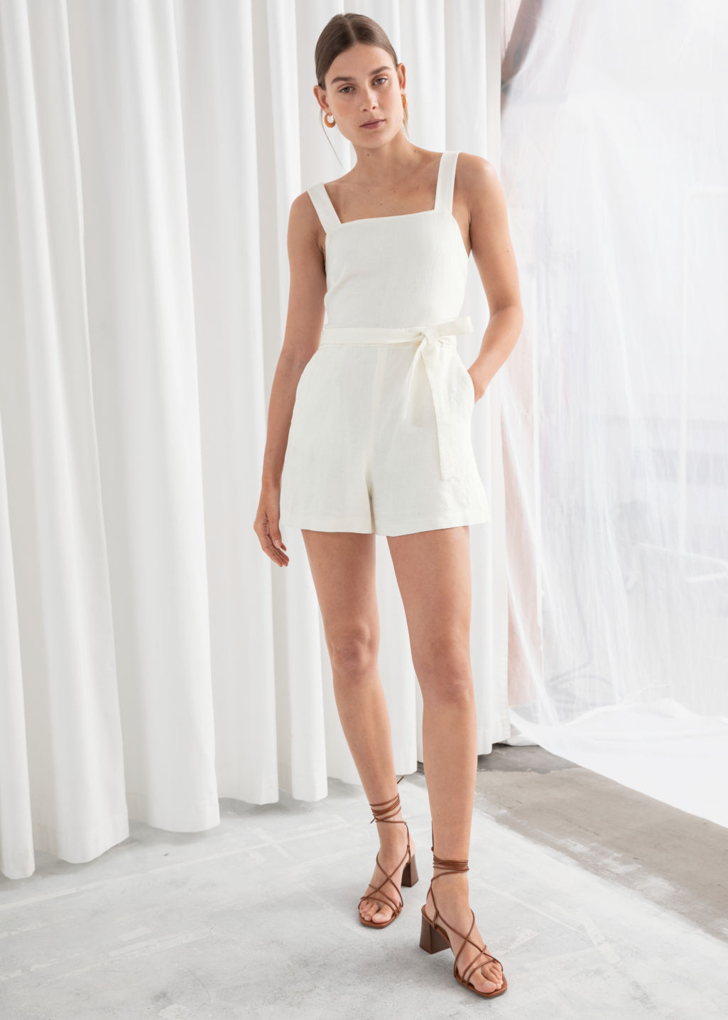 Model front image of Stories square neck linen romper in white