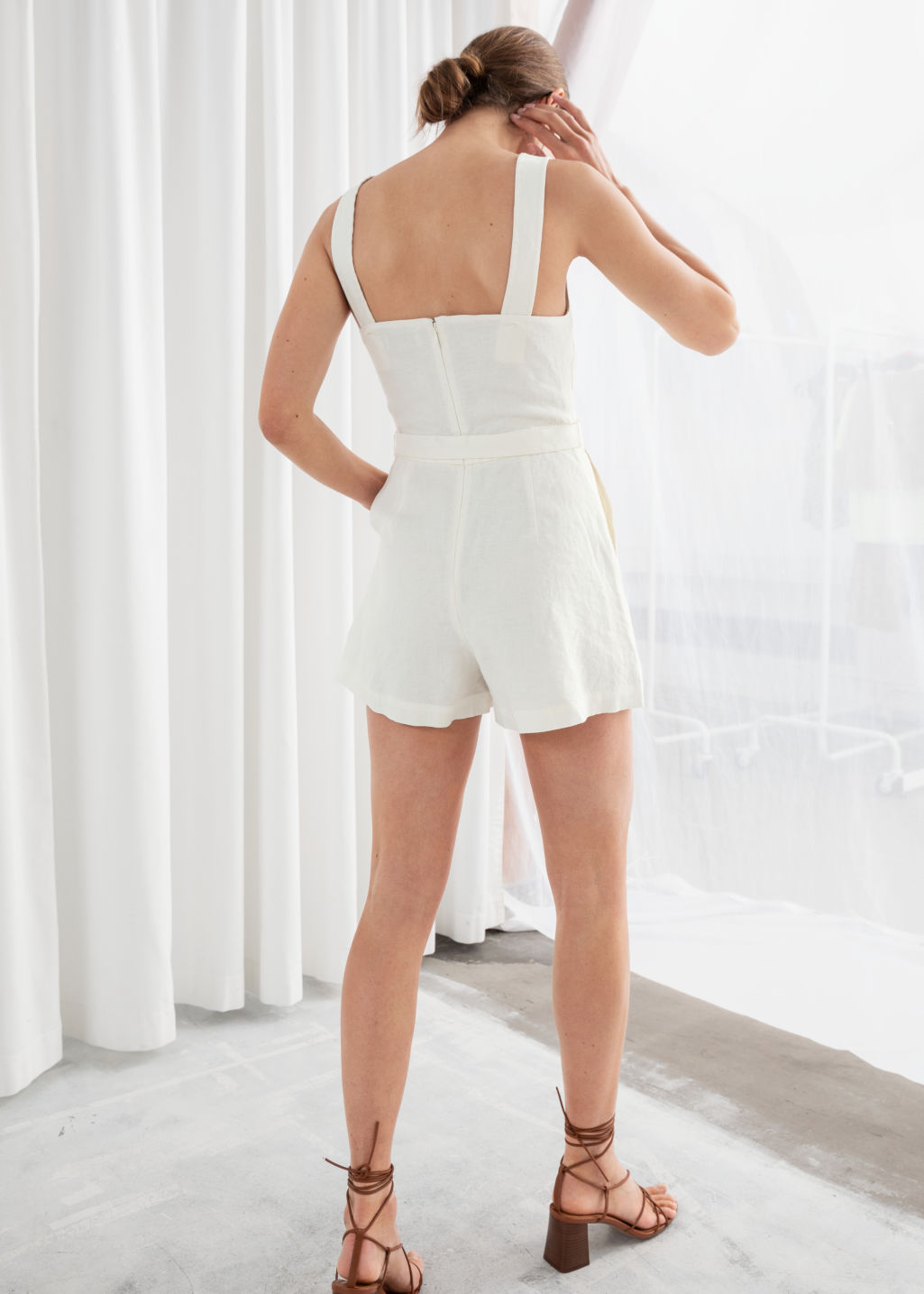 Model back image of Stories square neck linen romper in white