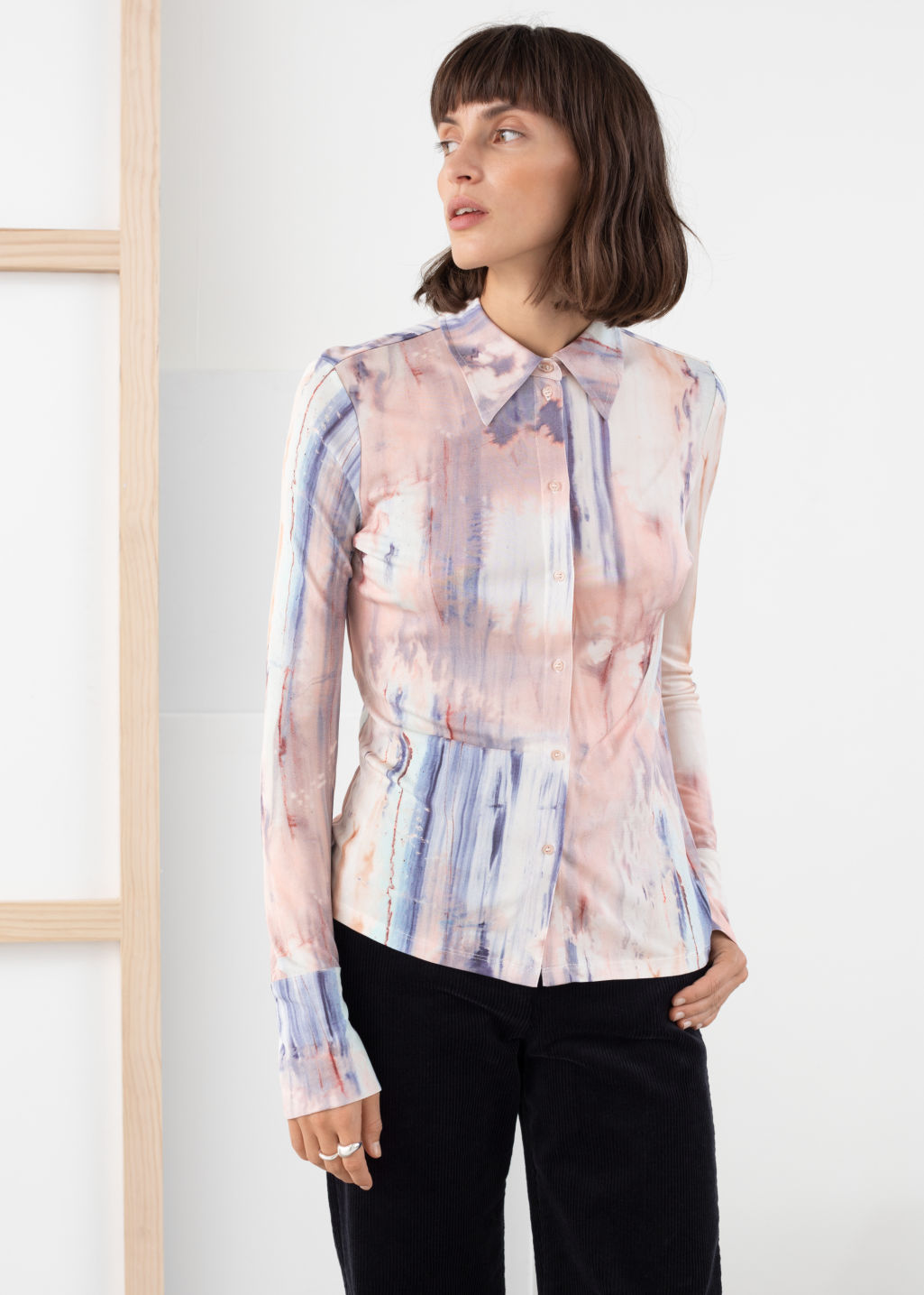 Model front image of Stories floral button up blouse in blue