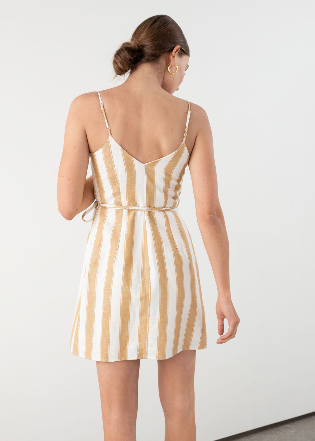 Model back image of Stories striped cotton linen mini wrap dress in yellow
