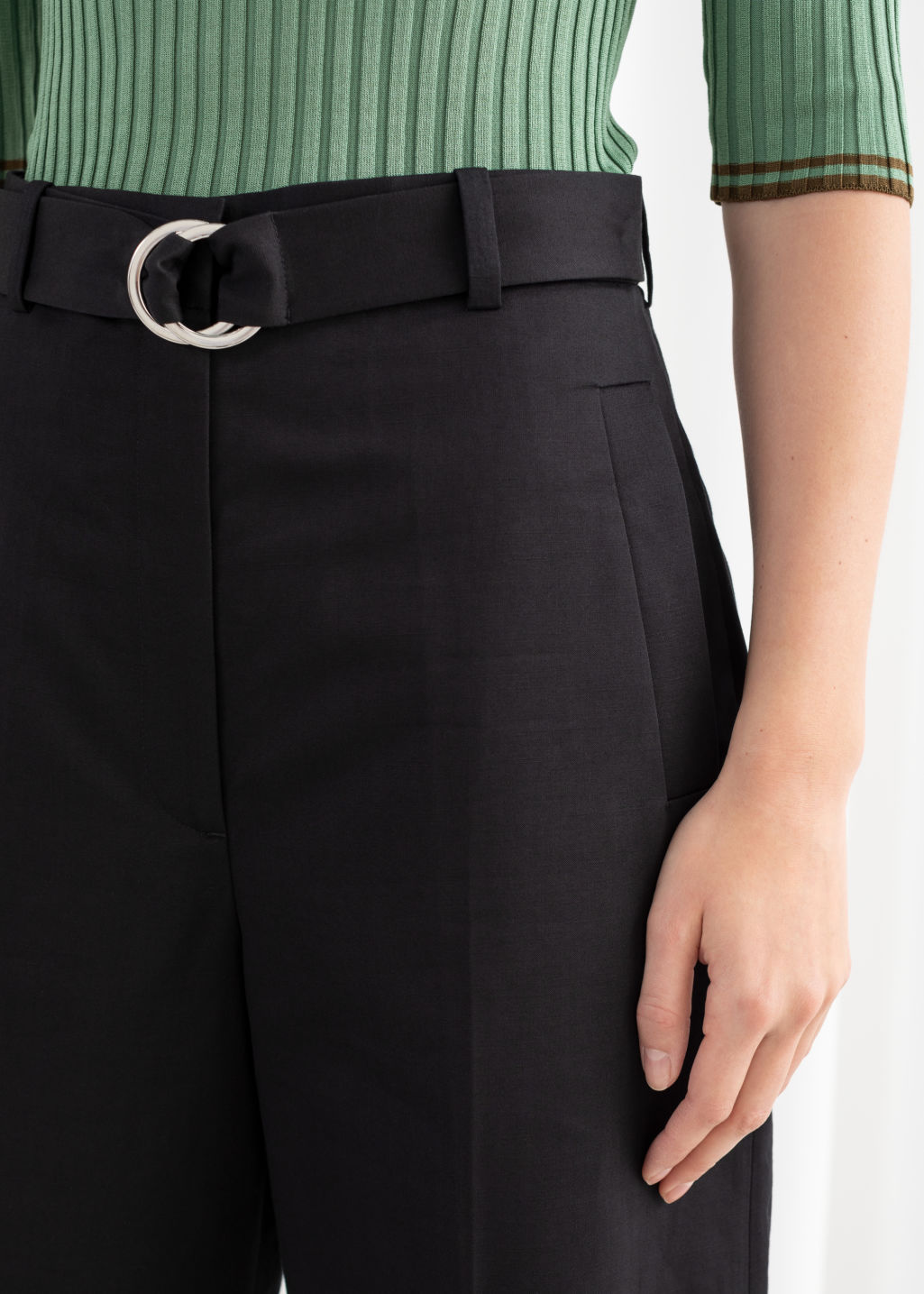 Model back image of Stories cropped cotton blend belted trousers in black