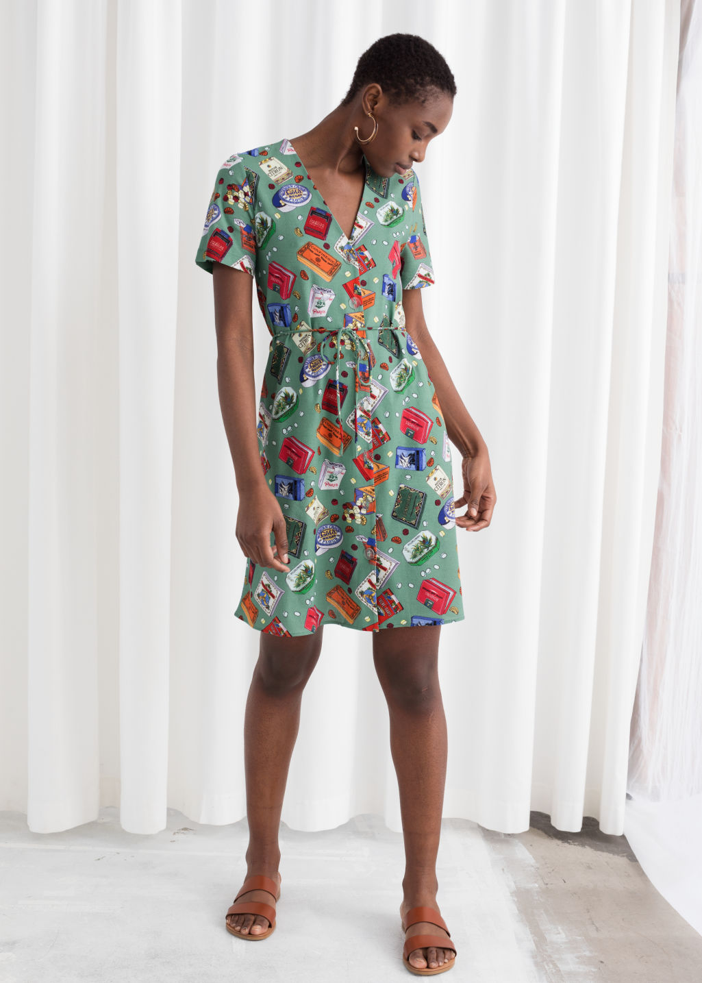 Model back image of Stories belted candy print cotton dress in green
