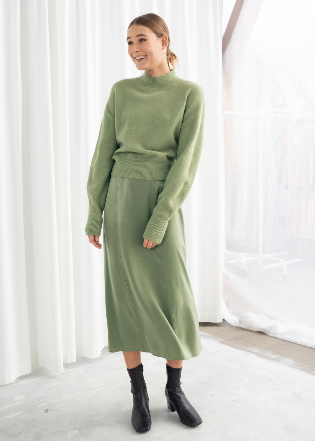Model front image of Stories a-line midi skirt in green