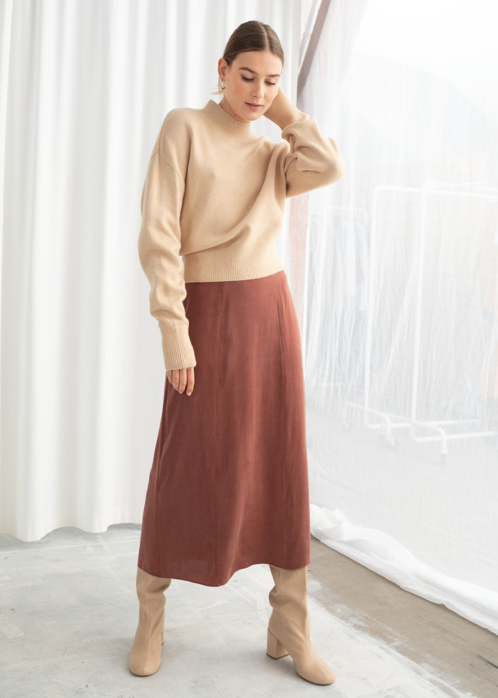 Model front image of Stories a-line midi skirt in orange