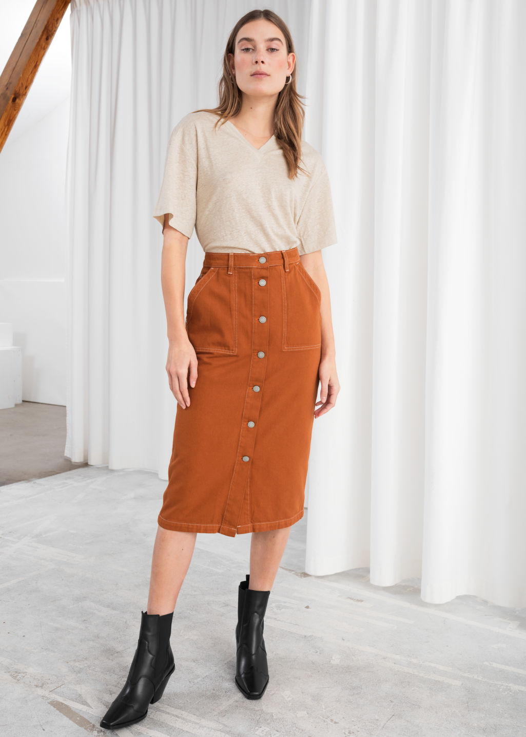 Model front image of Stories mid rise denim midi skirt in orange