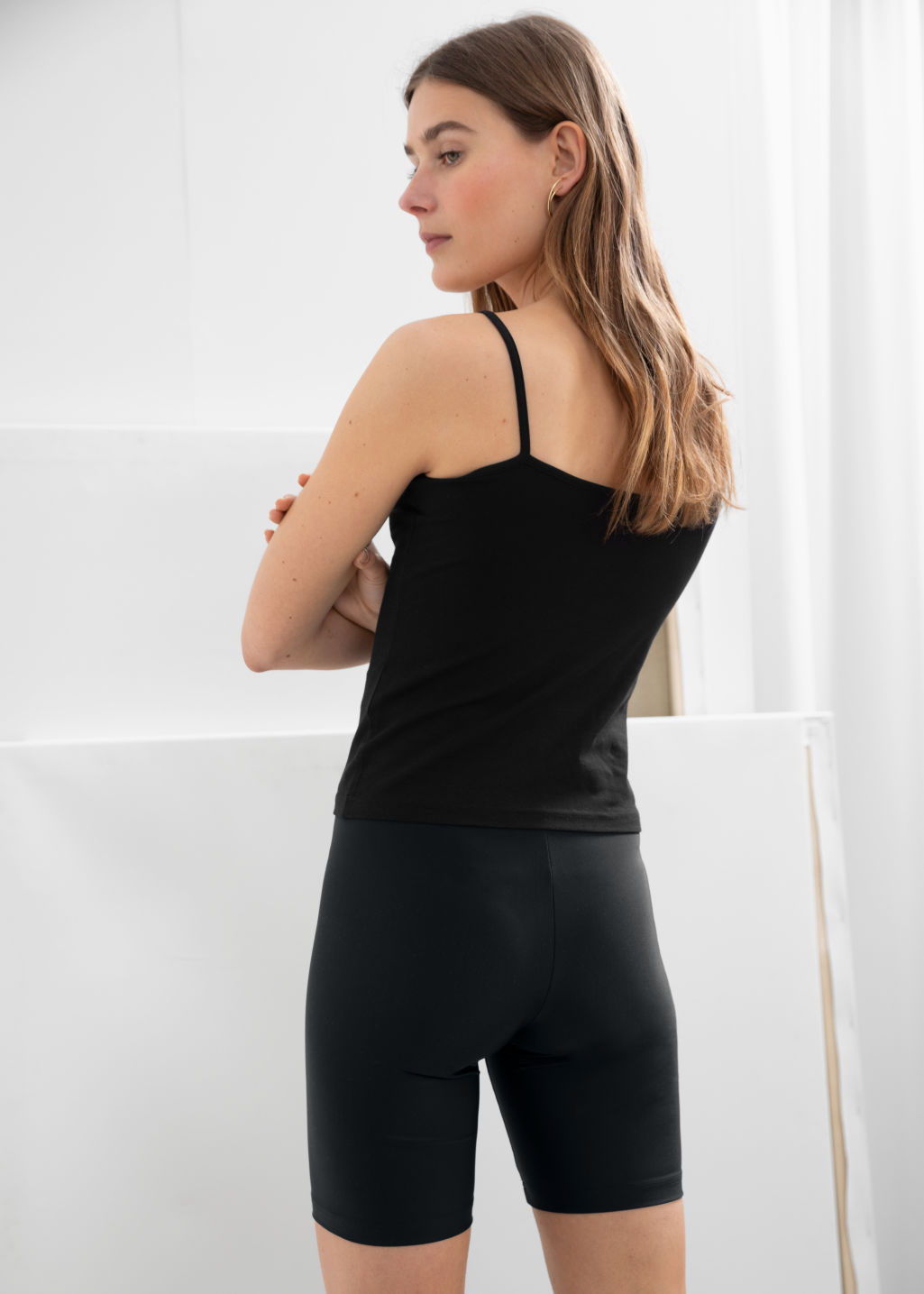 Model back image of Stories fitted cycling shorts in black