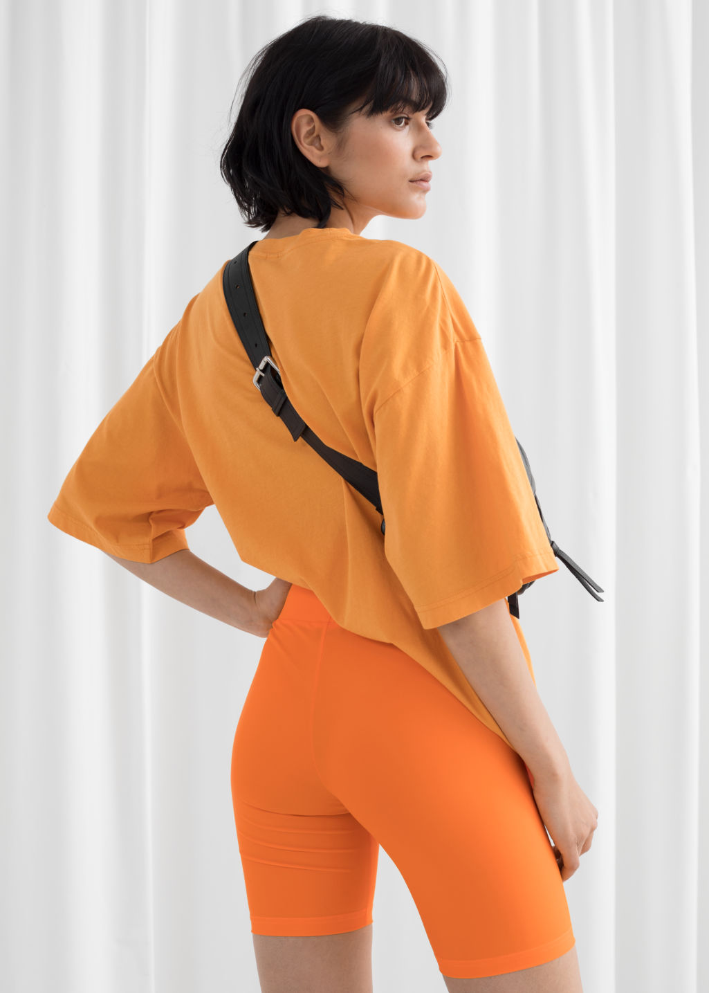 Model back image of Stories fitted cycling shorts in orange
