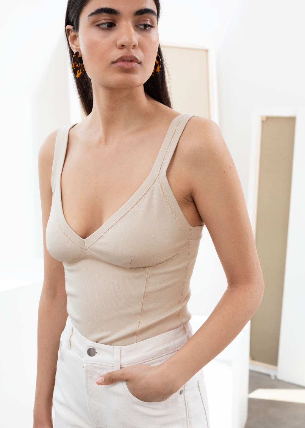 Model front image of Stories fitted tank top in beige