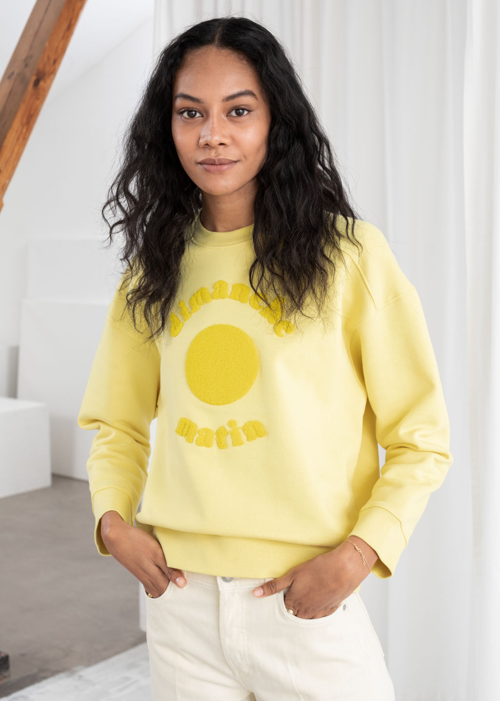 Model front image of Stories dimanche matin cotton pullover in yellow