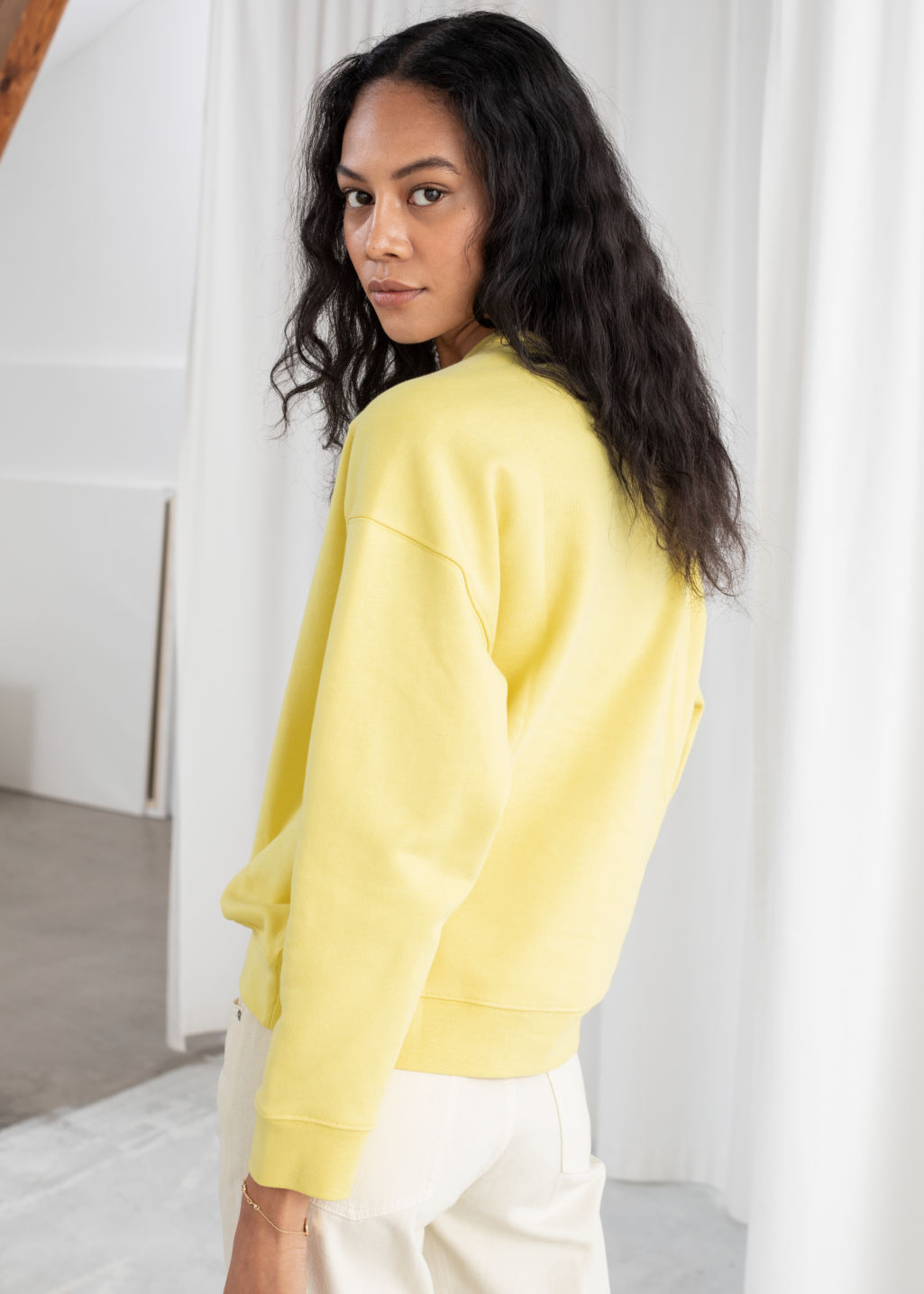Model back image of Stories dimanche matin cotton pullover in yellow