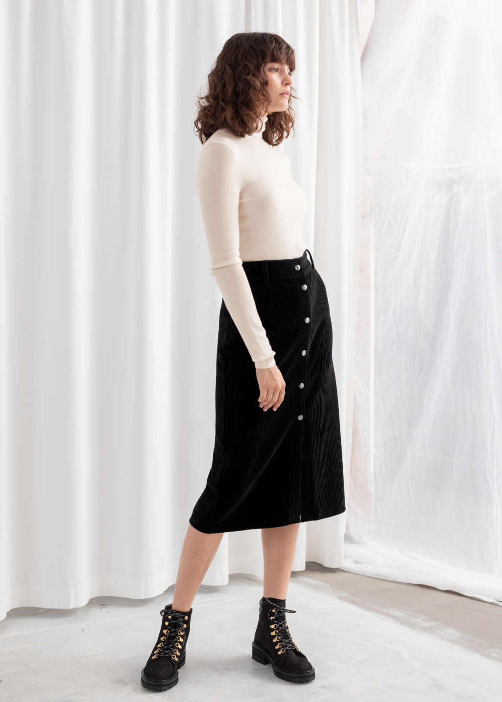 Model front image of Stories velvet midi pencil skirt in black
