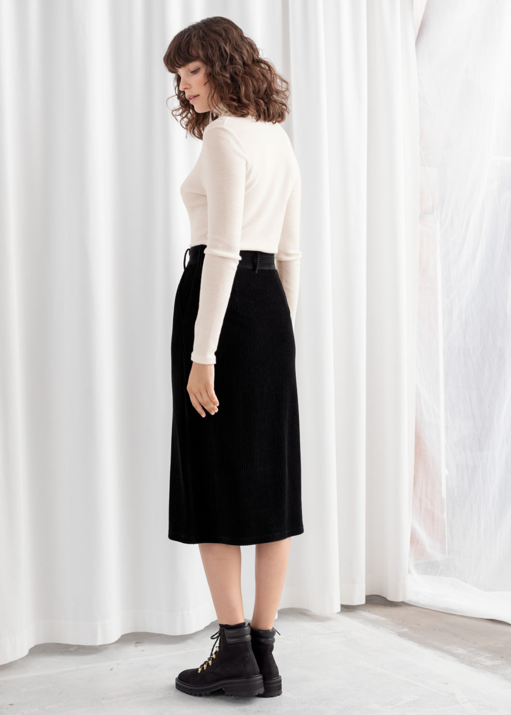 Model back image of Stories velvet midi pencil skirt in black